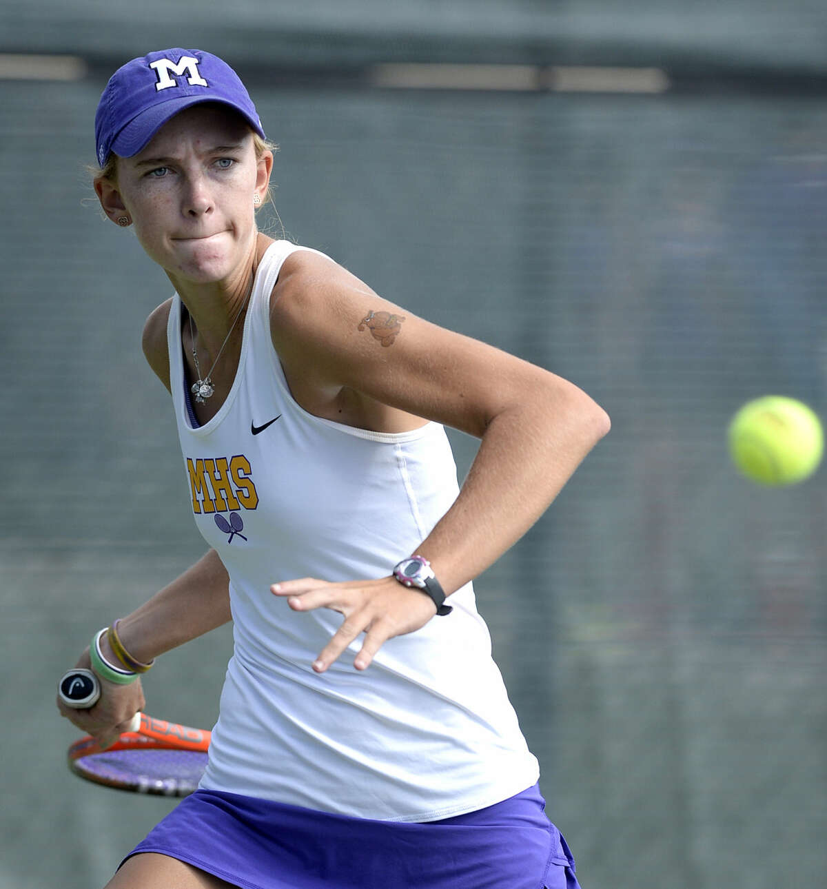 Midland High's Kate Daugherty competes in the District 3-6A tennis match against Abilene High on Saturday, Sept. 12, 2015 at the Midland High Tennis Center. James Durbin/Reporter-Telegram