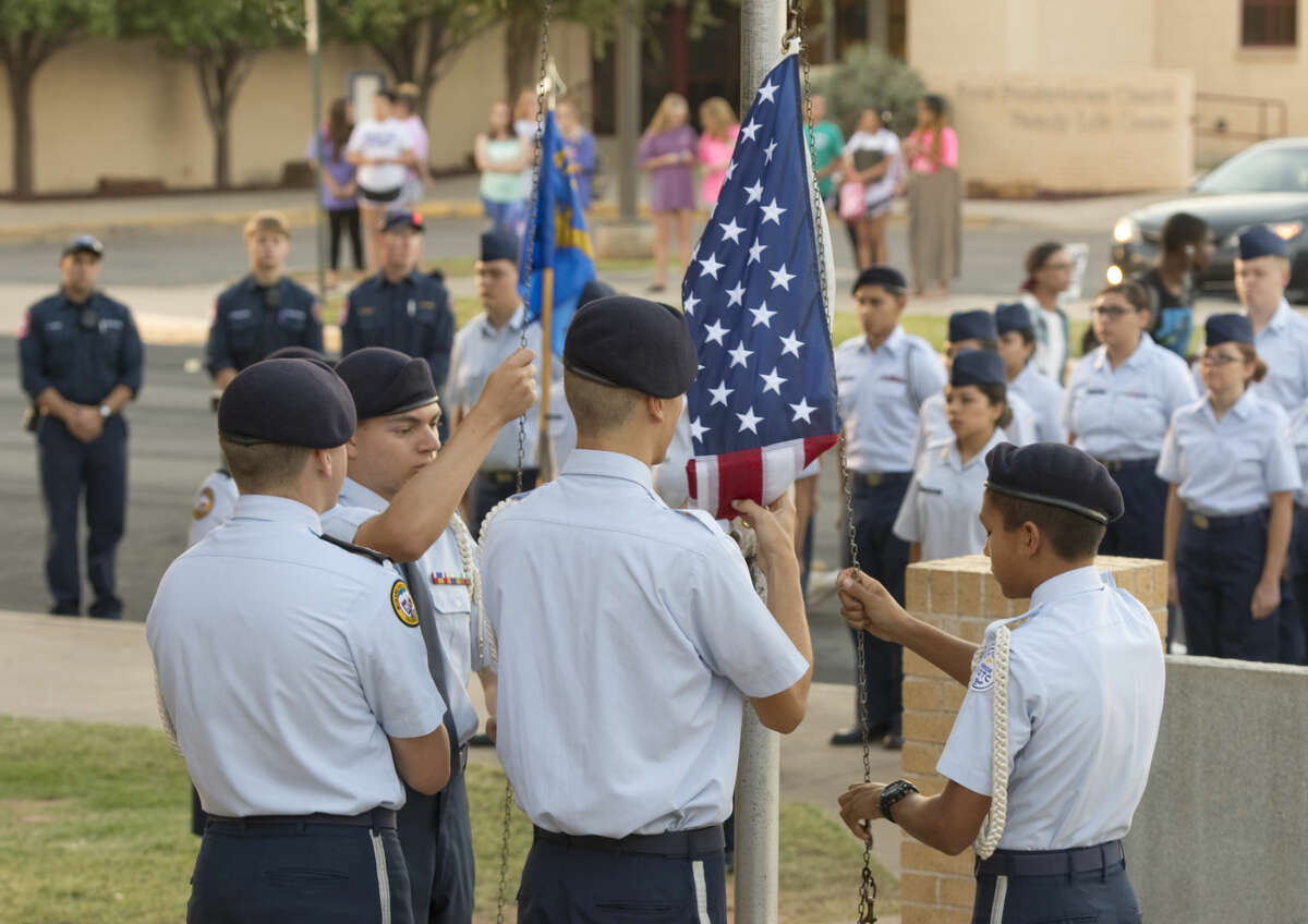 Members of Midland High JrROTC Honor Guard raise the flag Friday 9-11-2015 during the Patriot Day Ceremony outside MHS. Tim Fischer\Reporter-Telegram