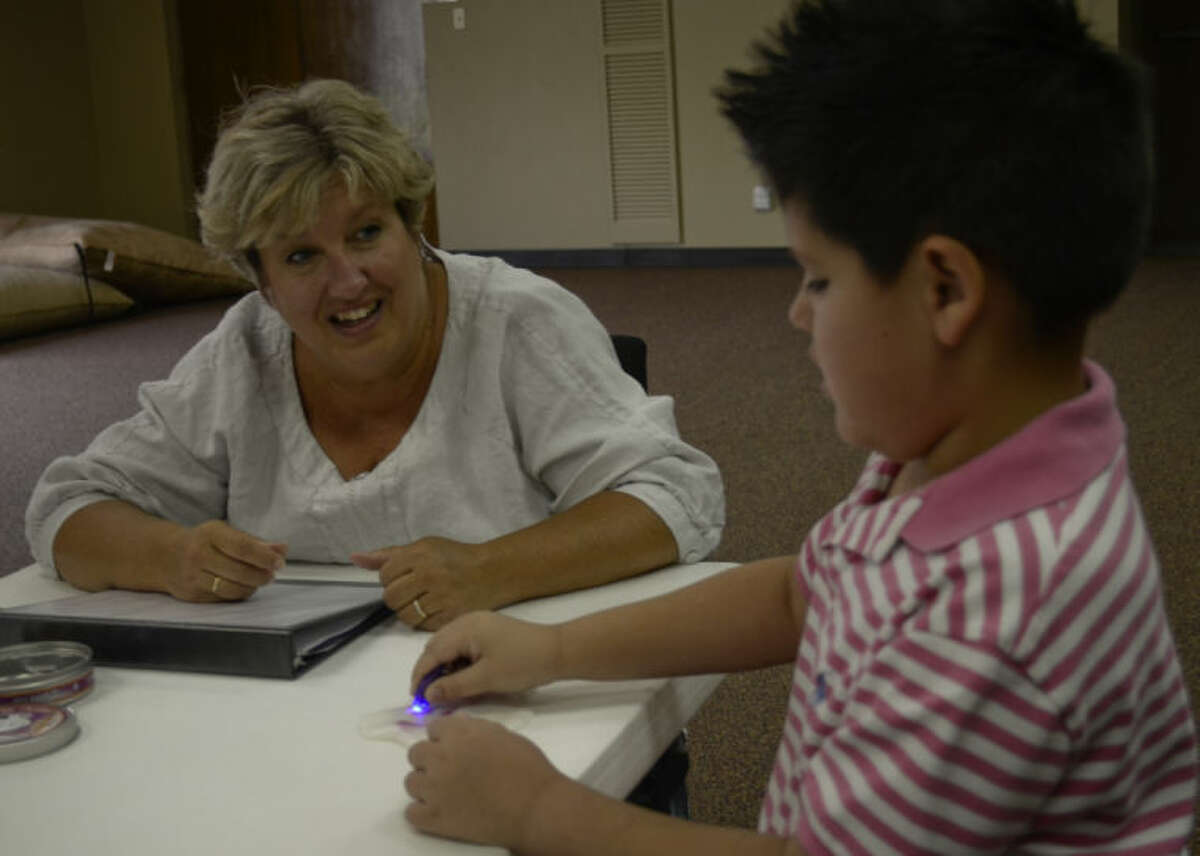 Wende Parsley, founder of Jeremiah School, works with Levi Nieto, 8, who will be a third grader at the new school when class starts this fall. Tim Fischer\Reporter-Telegram