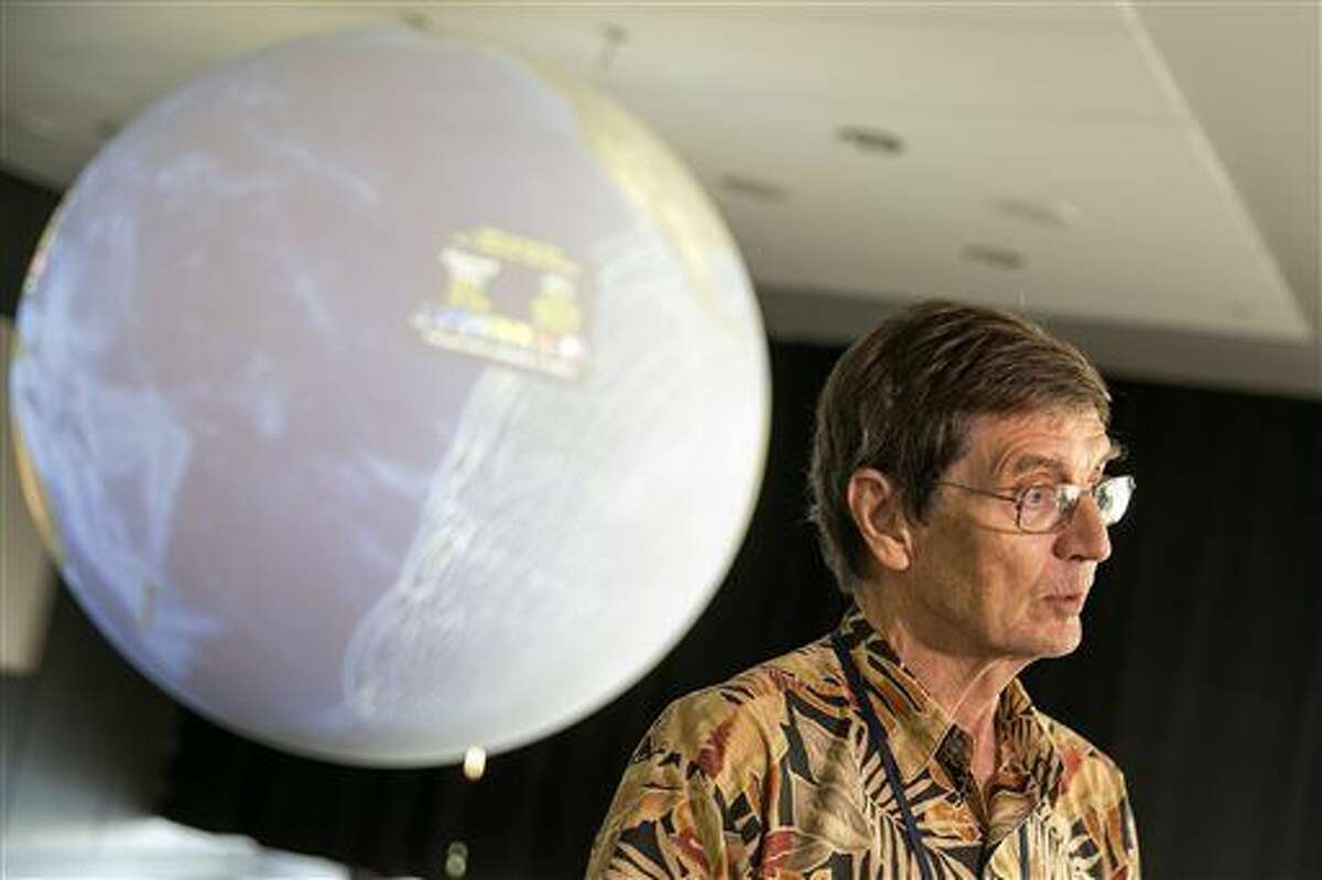 TSUNAMI WATCH -Geophysicist Dr. Gerard J. Fryer, announces the tsunami watch for Hawaii has changed to a tsunami advisory at the Pacific Tsunami Warning Center on Ford Island at Joint Base Pearl Harbor-Hickam Hawaii, Wednesday, Sept. 16, 2015, in Honolulu. A powerful magnitude-8.3 earthquake hit off Chile's northern coast Wednesday night putting Hawaii under a tsunami watch. (AP Photo/Marco Garcia)