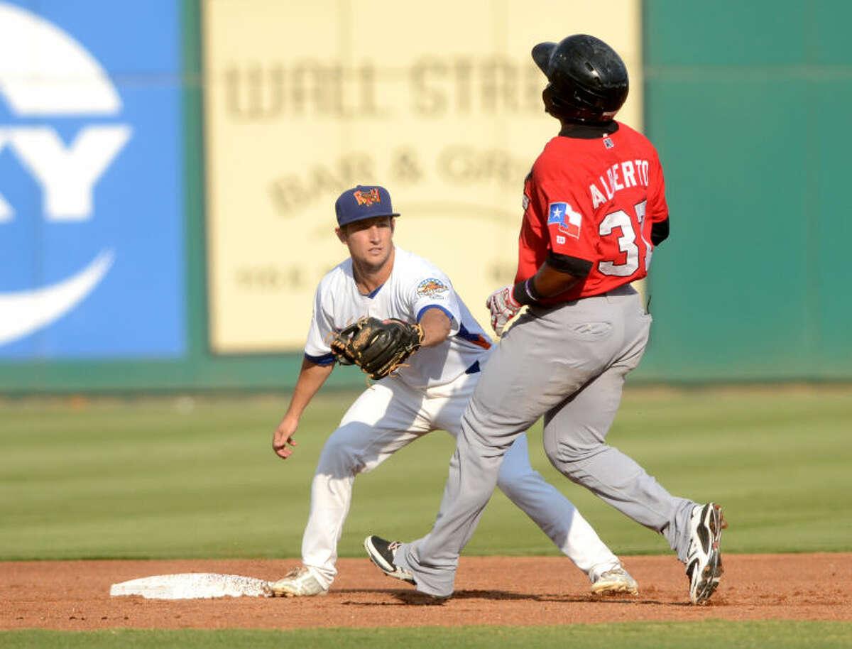Rockhounds second baseman Conner Crumbliss tags out Frisco's Hanser Alberto on Wednesday at Security Bank Ballpark. James Durbin/Reporter-Telegram