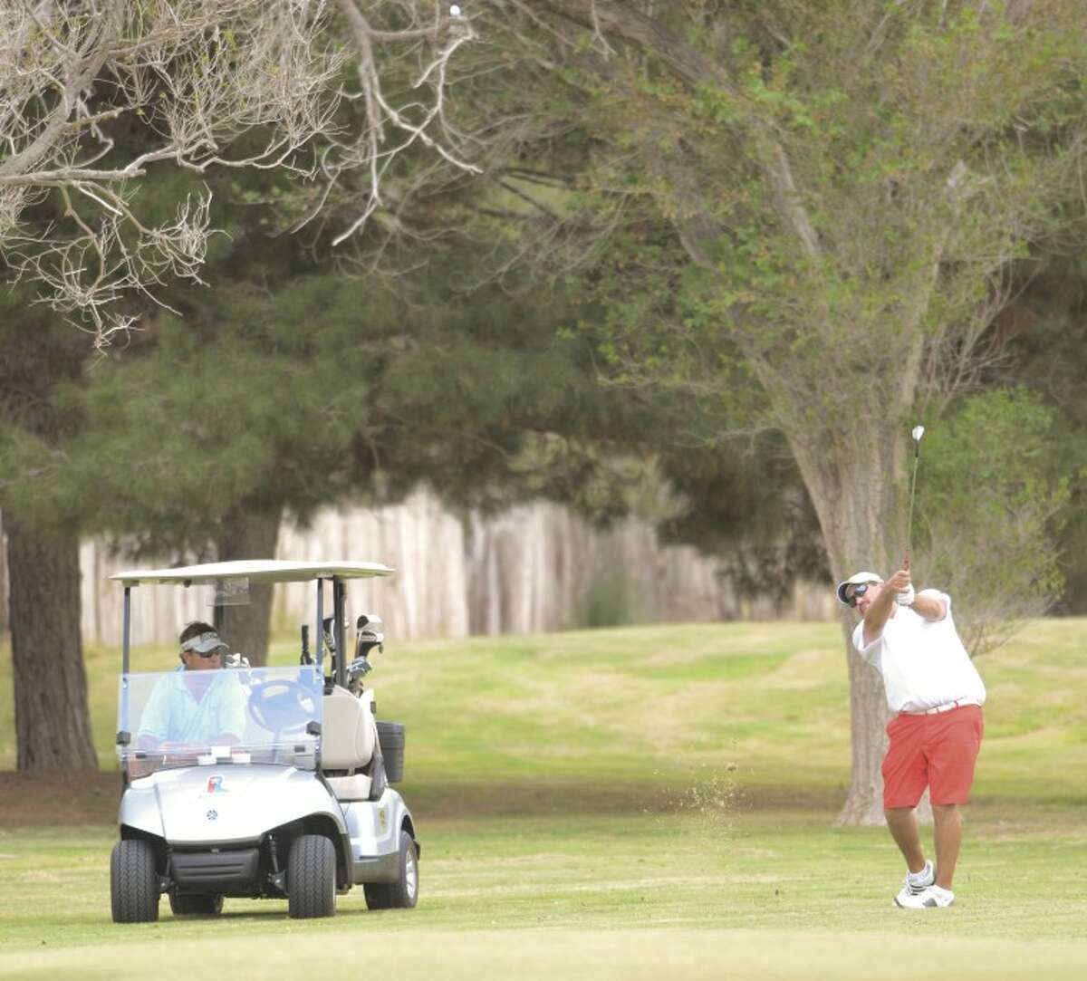 Ken Livingston watch as Mark Terry chips his ball onto No. 2 green during the first round of the Ranchland Hills Blowout in 2012. Cindeka Nealy/Reporter-Telegram