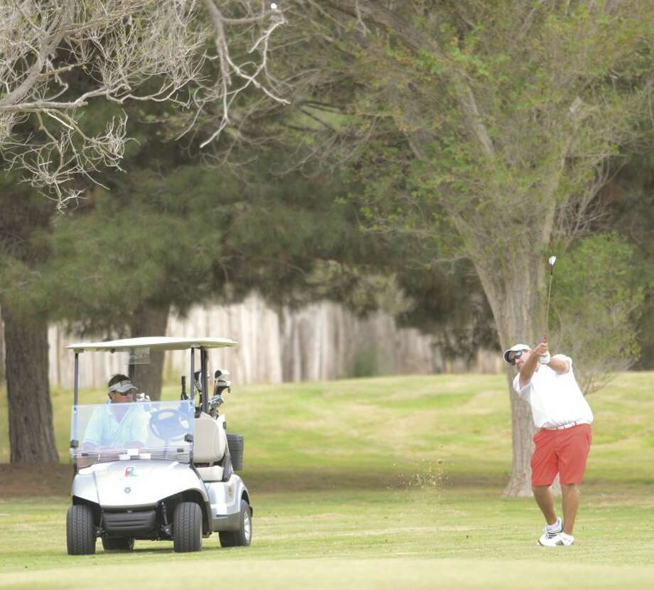 Ken Livingston watch as Mark Terry chips his ball onto No. 2 green during the first round of the Ranchland Hills Blowout in 2012. Cindeka Nealy/Reporter-Telegram Photo: Cindeka Nealy
