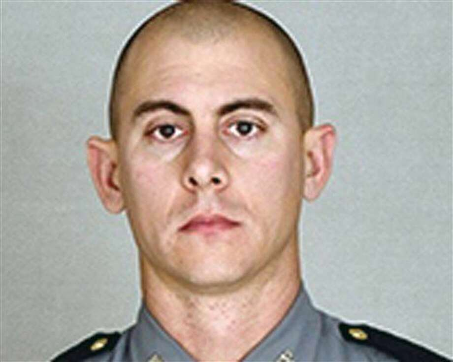 This undated photo provided by the Kentucky State Police shows Trooper Joseph Cameron Ponder. Ponder, who had been on the force less than a year was killed, late Sunday, Sept. 13, 2015, in a shooting during a car chase on Interstate 24, in Kentucky. Authorities are searching for the suspect. (Courtesy of the Kentucky State Police via AP) Photo: Associated Press