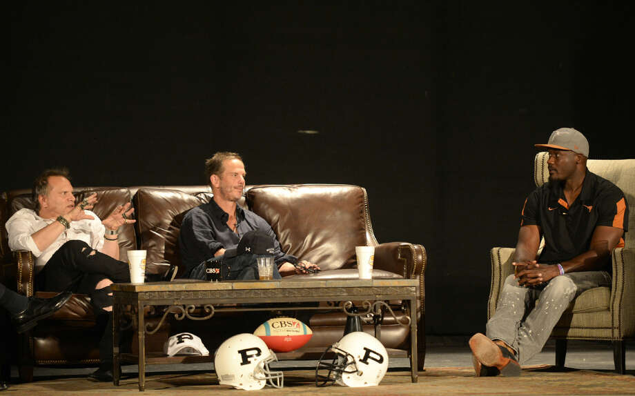 """From left, Buzz Bissinger, author of the book """"Friday Night Lights,"""" Peter Berg, director of the movie """"Friday Night Lights,"""" and football player Roy Williams speak during a panel discussion also featuring football player Brian Chavez on Tuesday, Sept. 15, 2015, at the Yucca Theater. James Durbin/Reporter-Telegram Photo: James Durbin"""