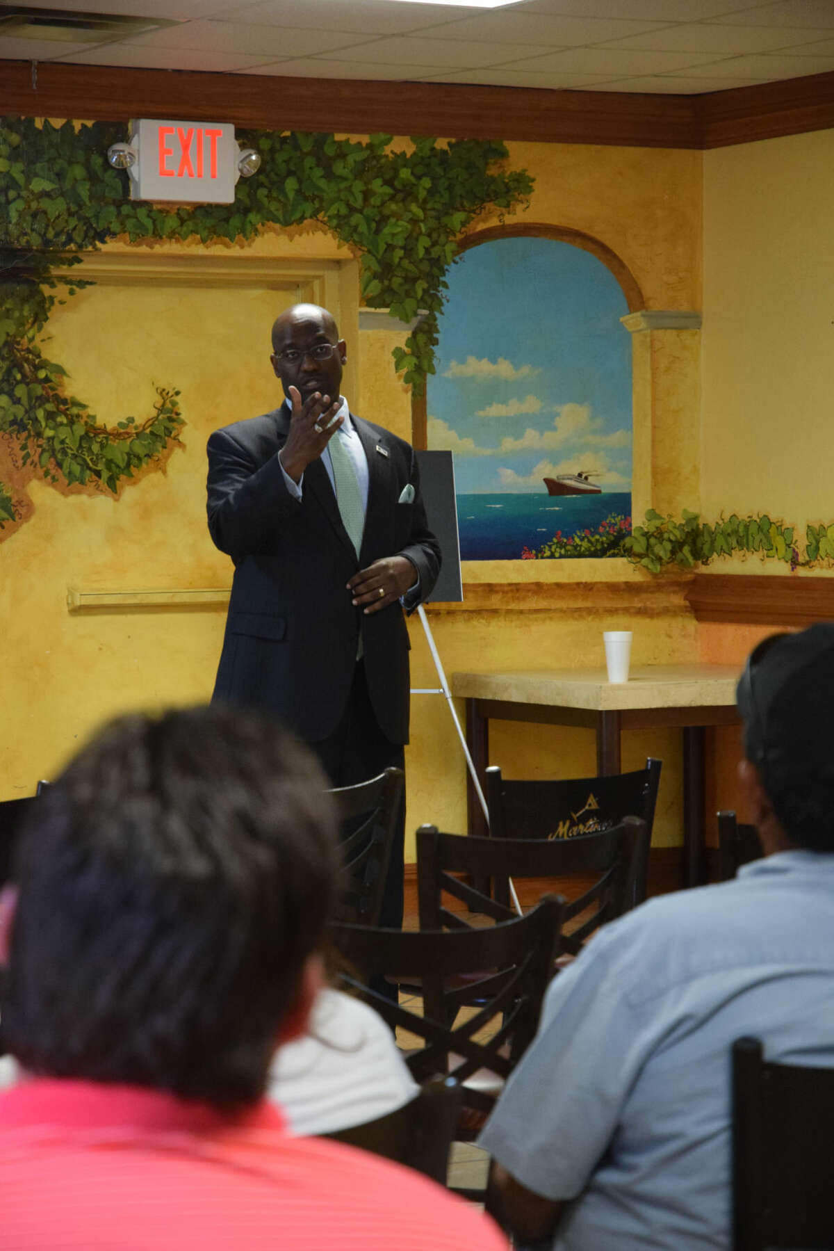 Midland's District 2 councilman John Love III speaks with constituents about their mineral rights at a town hall meeting in Martinez Bakery on September 15,205