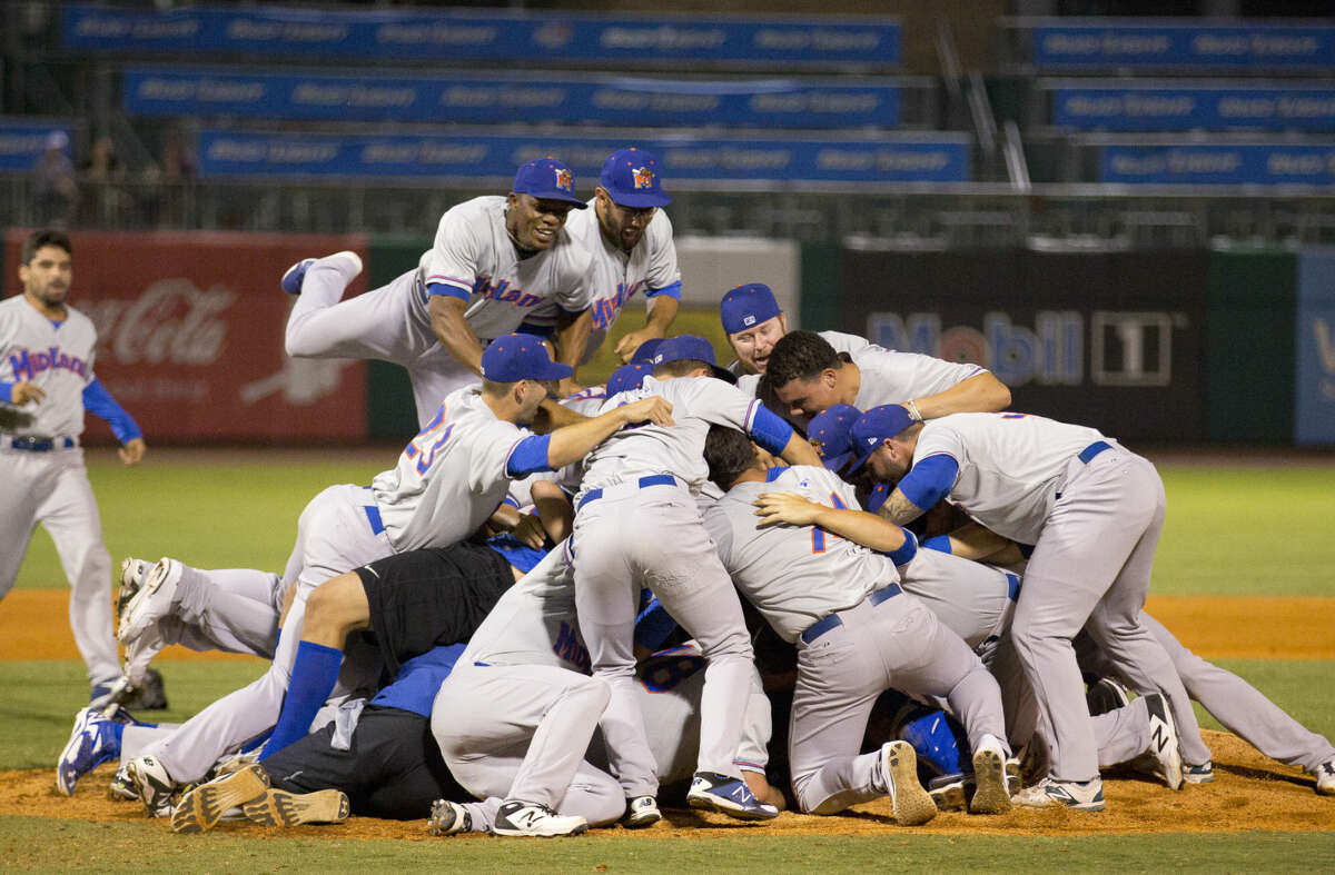 The Rockhounds begin celebrating their 7-0 victory over the Northwest Naturals to clinch the Texas League Championship at Arvest Ballpark in Springdale, Akansas, on Friday.