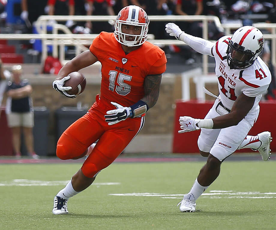 UTEP's Darrin Laufasa runs the ball as Tech's Malik Jenkins chases during an NCAA college football game Saturday, Sept. 12, 2015, in Lubbock, Texas. (Allison Terry/Lubbock Avalanche-Journal via AP) Photo: Allison Terry