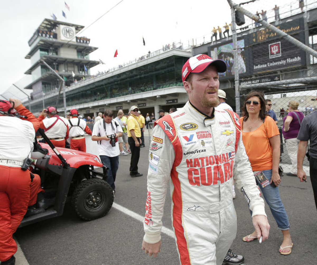 Dale Earnhardt Jr walks back to the garage after qualifying for the Brickyard 400 auto race at the Indianapolis Motor Speedway in Indianapolis, Saturday, July 26, 2014. (AP Photo/AJ Mast)