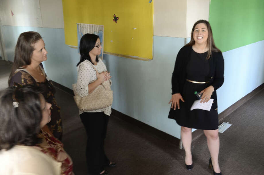 Abbie Kauffman, right, with Centers for Children and Families, gives a tour of the new facilities Wednesday morning. Tim Fischer\Reporter-Telegram Photo: Tim Fischer