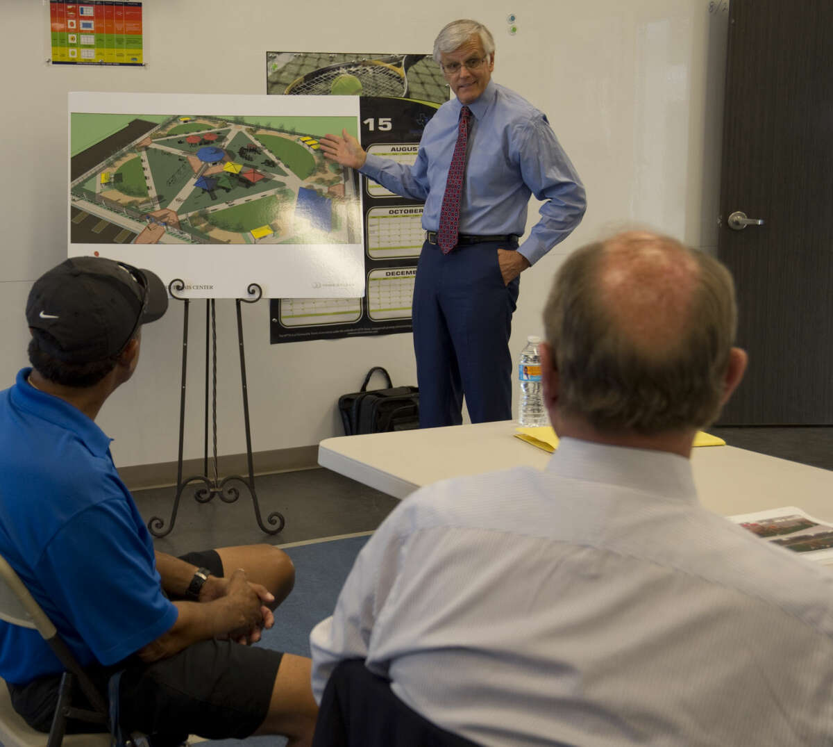 George Irish, former MRT publisher and current board member of the Hearst Foundation, listens to a presentation Wednesday 8-26-2015 by Steve Davidson at the Bush Tennis Center, location for the new Opportunity Park. Tim Fischer\Reporter-Telegram