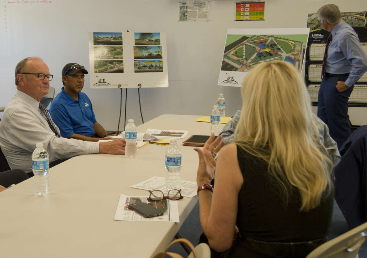 George Irish, former MRT publisher and current board member of the Hearst Foundation, left, listens to a presentation Wednesday 8-26-2015 by Steve Davidson, standing as Jan Davidson, right, gives some background at the Bush Tennis Center, location for the new Opportunity Park. Tim Fischer\Reporter-Telegram