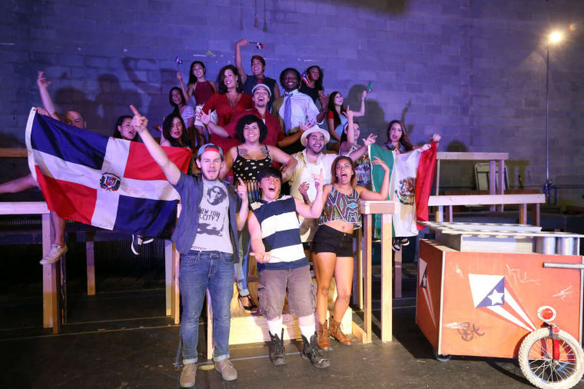 The cast of 'In The Heights' celebrate Carnevale del Barrio during a rehearsal Wednesday at the Permian Playhouse.
