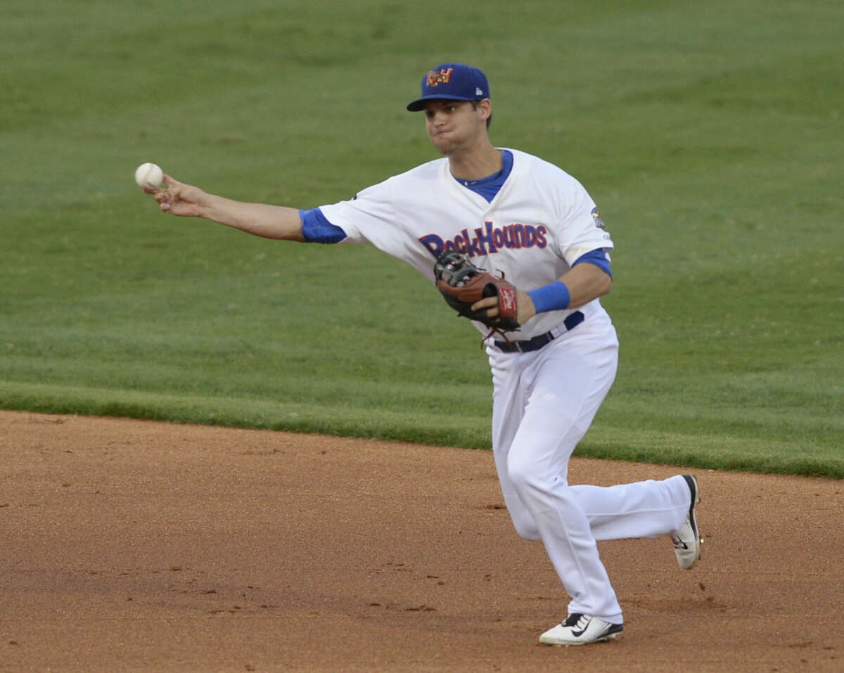 Rockhounds Chad Pinder fields the ball against Corpus Christi in game three of the Texas League South Division Championship Series on Friday, Sept. 11, 2015 at Security Bank Ballpark. James Durbin/Reporter-Telegram