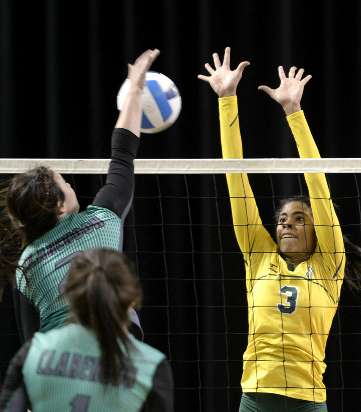 Midland College's Yehelis Villegas (3) attempts to block a shot from Clarendon College's Taylor Opitz on Wednesday, Sept. 9, 2015, at Chaparral Center. James Durbin/Reporter-Telegram