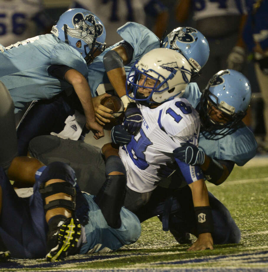 Greenwood defenders swarm to bring down Lake View QB Henry Nickias Friday 9-16-2015 at J.M. King Memorial Stadium in Greenwood. Tim Fischer\Reporter-Telegram Photo: Tim Fischer