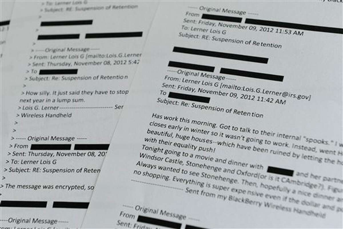 """Lois Lerner emails obtained from the House Ways and Means Committee are displayed in Washington, Wednesday, July 30, 2014. A former IRS official at the heart of the agency's tea party controversial called Republicans """"crazies"""" and more in newly released emails. Lois Lerner used to head the IRS division that handles applications for tax-exempt status. In a series of emails with a colleague in November 2012, Lerner made two disparaging remarks about members of the GOP, including one remark that was profane. Republican Rep. Dave Camp, who chairs the House Ways and Means Committee, released the emails Wednesday as part of his committee's investigation. Camp says the emails show Lerner's disgust with conservatives. (AP Photo/Susan Walsh)"""