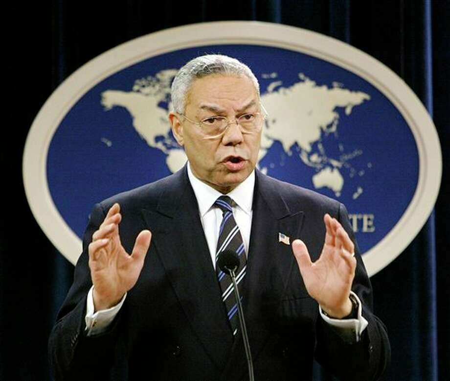 FILE - In this Jan. 8, 2004, file photo, then-Secretary of State Colin Powell speaks at a news conference in Washington at the State Department. A document circulating among White House staff says a Senate report on the CIA's interrogation and detention practices after the 9/11 attacks concludes that the agency initially kept Powell and some U.S. ambassadors in the dark about harsh techniques and secret prisons. (AP Photo/J. Scott Applewhite, File) Photo: J. SCOTT APPLEWHITE / AP