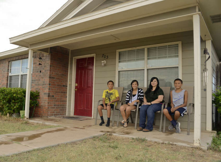 Gloria Ely and her children, Adrian, Amber and Anthony Ramon talk about her experience as a Habitat home owner. Tim Fischer\Reporter-Telegram Photo: Tim Fischer