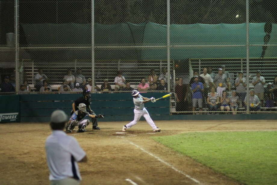 Jordan Matthews hits the game-winning home run for the Mid City Intermediate All-Stars during Thursday's night game against San Ramon, Calif., in the Intermediate 50/70 World Series.Photo by Bill Nale