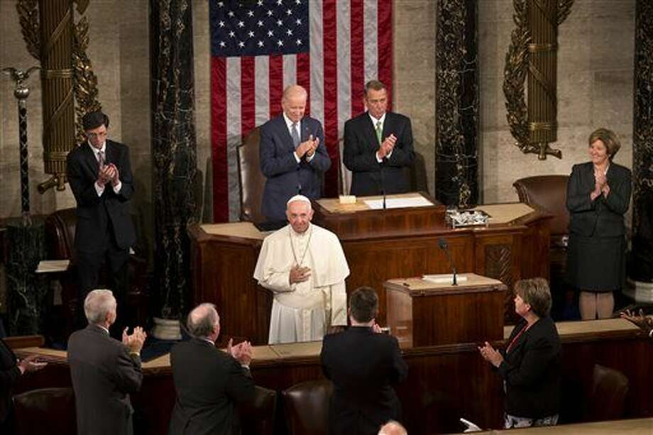 Pope Francis listens to applause before addressing a joint meeting of Congress on Capitol Hill in Washington, Thursday, Sept. 24, 2015, making history as the first pontiff to do so. (AP Photo/Alessandra Tarantino) Photo: Alessandra Tarantino / AP