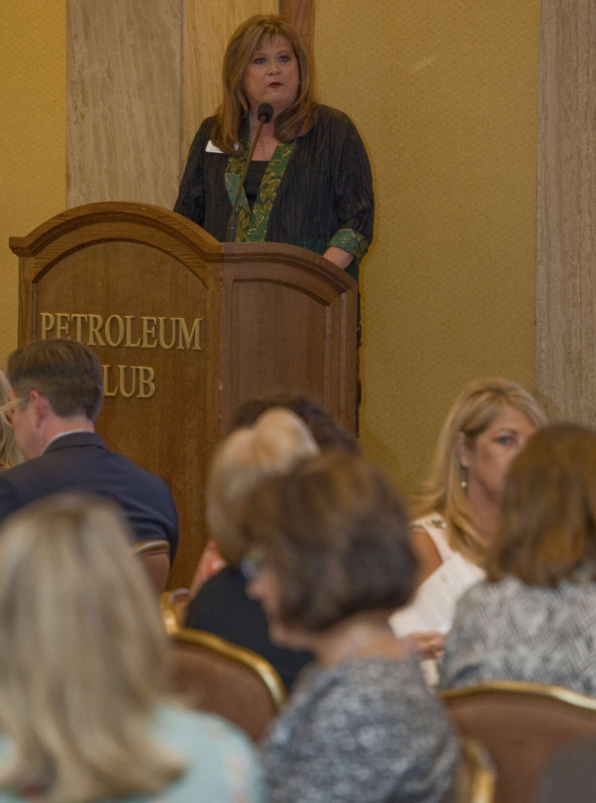 Laurie Johnson, director for Non-profit Management Center, welcomes everyone to the 2015 Beacon Awards luncheon Tuesday 9-22-2015. Tim Fischer\Reporter-Telegram