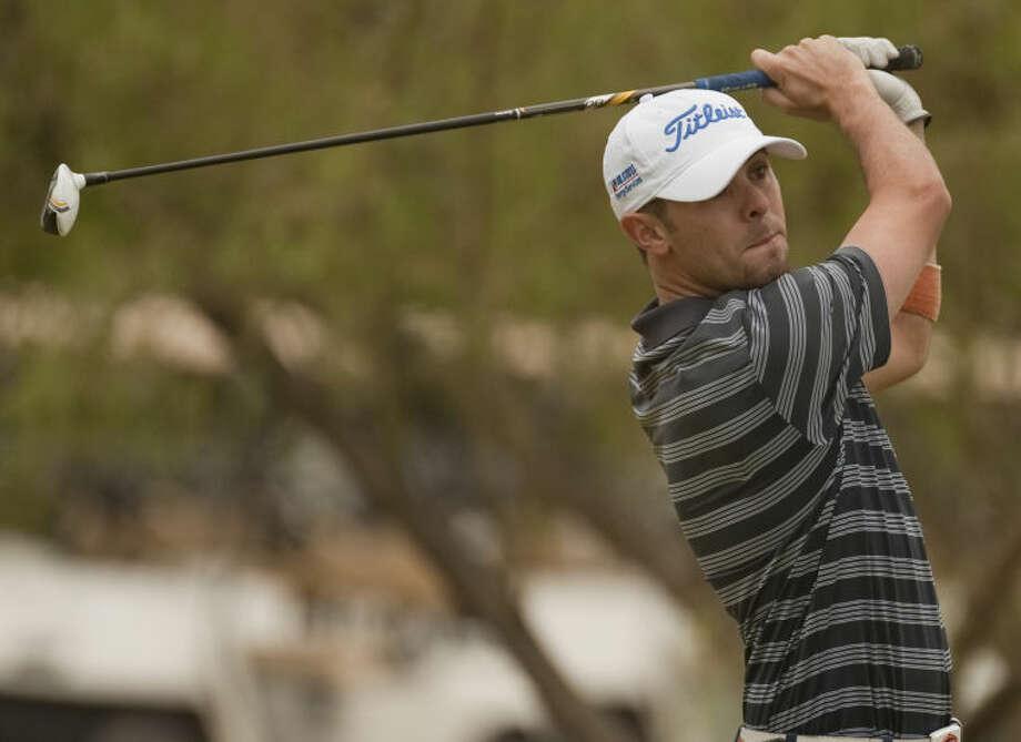 Ryan Fioretti follows his shot Saturday at Hogan Park Golf Course during the Midland Men's City Championship. Tim Fischer\Reporter-Telegram Photo: Tim Fischer