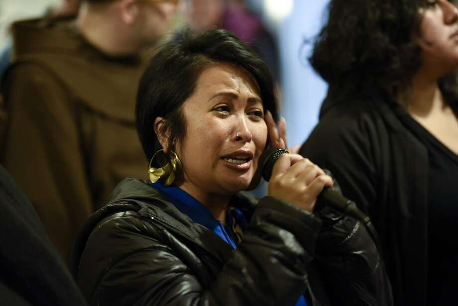 "Jo Cruz of San Francisco wipes away tears as she speaks in support of protesters supporting the ""Frisco Five"" hunger strikers as they clash with police officers in front of the mayors office at City Hall in San Francisco in San Francisco, CA, Friday, May 6, 2016. Photo: Michael Short, Special To The Chronicle"