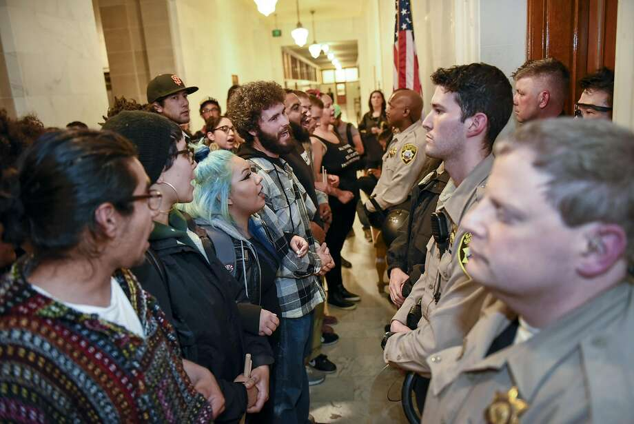 "Protesters supporting the ""Frisco Five"" hunger strikers clash with police officers in front of the mayors office at City Hall in San Francisco in San Francisco, CA, Friday, May 6, 2016. Photo: Michael Short, Special To The Chronicle"