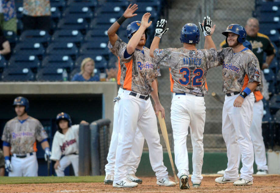 Rockhounds' Kent Matthes (32) gets congratulated by teammates after hitting a grand slam home run against Corpus Christi on Thursday at Security Bank Ballpark. James Durbin/Reporter-Telegram Photo: James Durbin