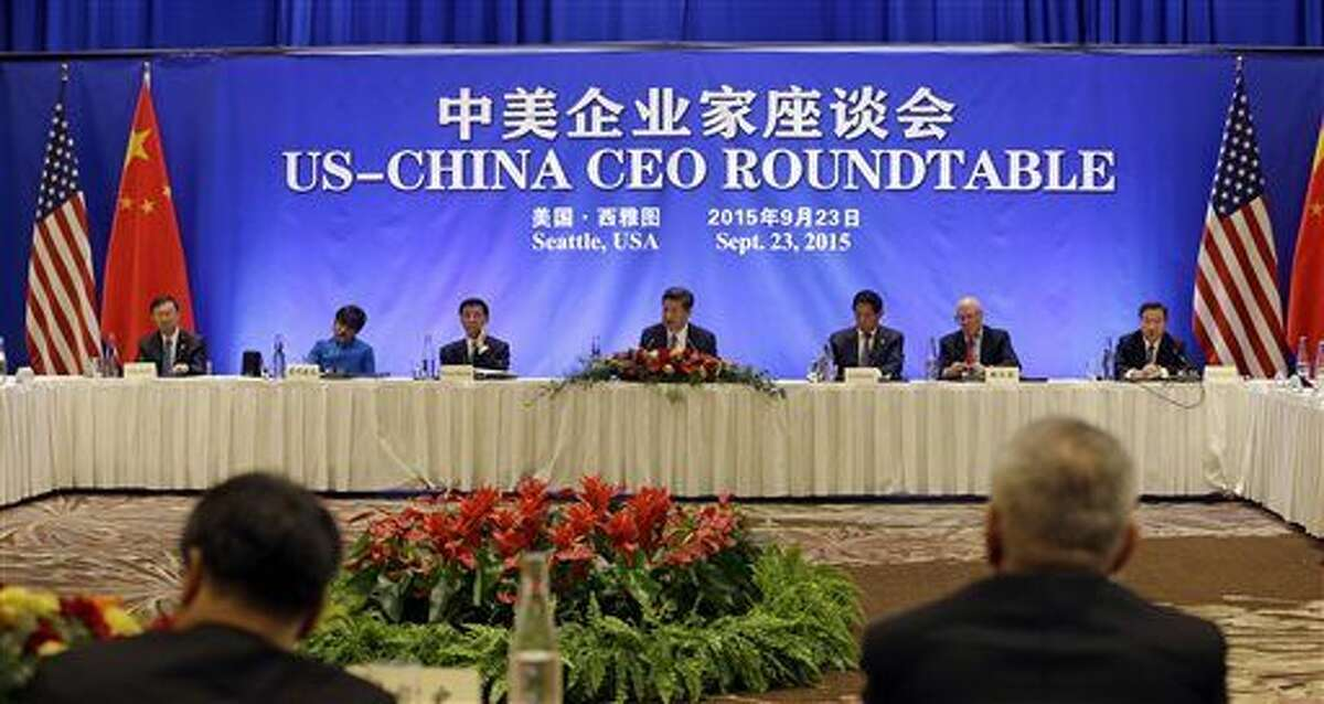 Chinese President Xi Jinping, center, addresses a U.S.-China business roundtable, comprised of U.S. and Chinese CEOs, Wednesday, Sept. 23, 2015, in Seattle. From left are Yang Jiechi, U.S. Commerce Secretary Penny Pritzker, Wang Huning, Xi, Li Zhanshu, former U.S. Treasury Secretary Henry Paulson and Jiang Zengwei. The Paulson Institute, in partnership with the China Council for the Promotion of International Trade, co-hosted the event. (AP Photo/Elaine Thompson, Pool)