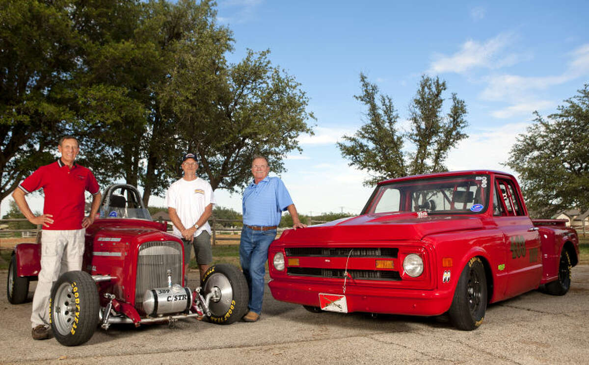 From left, Bruce Brady, Tom Kuhn and Oren Albright stand with their Bonneville salt flat racecars, a 1929 Ford powered by a 358 cubic inch Chevy engine and a 1969 Chevrolet C10 truck with a 305 cubic inch motor. James Durbin/Reporter-Telegram