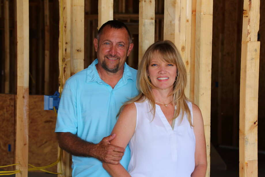 """While Larry Stevens handles the contracting and buildingportion of Stevens Construction, wife Callie, also aRealtor, focuses on administrative and marketing duties. Photographed for """"Home Front""""in the Sept. 27, 2015 issue of Midland Magazine. Photo by Curtis Routh"""