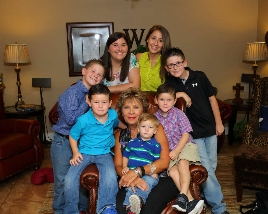 """Breast cancer survivor Mary Jane Wright pictured with her daughters and grandsons. From left toright, Brayden Wells, Jaxton Wells, Kristin Wells, Mary Jane Wright, Tytus Wells, Summer Wright,Jude Wells, Kaiden Wells. Photographed for """"Finding Strength in the Fight"""" in the Sept. 27, 2015 Midland Magazine. Photo by Curtis Routh"""