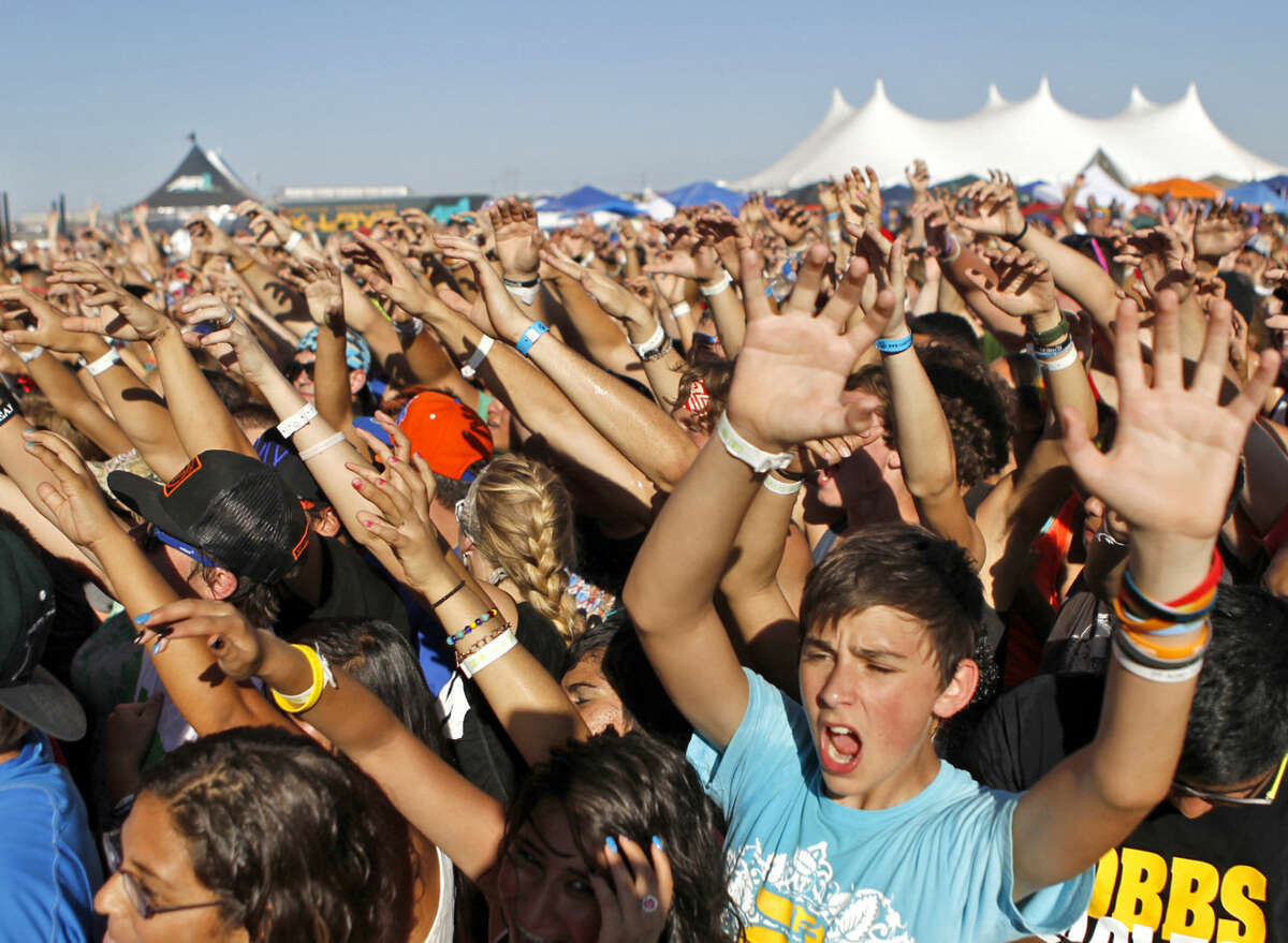 """Fans participate in a performance by the band """"Family Force 5"""" during Rock The Desert on Saturday. James Durbin/Reporter-Telegram"""