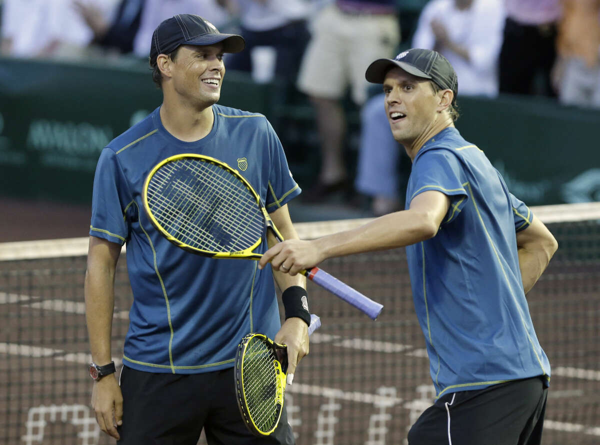 Bob, left, and Mike Bryan celebrate their win over Spain's David Marrero and Fernando Verdasco in the doubles final at the U.S. Men's Clay Court Championship tennis tournament Saturday, April 12, 2014, in Houston. The Bryan brothers won 4-6, 6-4, 11-9. (AP Photo/Pat Sullivan)