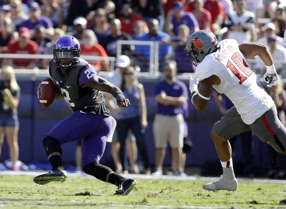 FILE - In this Oct. 25, 2014, file photo, TCU quarterback Trevone Boykin runs from Texas Tech linebacker Pete Robertson during an NCAA college football game in Fort Worth, Texas. The Horned Frogs had their way with the Red Raiders last season in Fort Worth, beating Texas Tech 82-27. The teams meet on Saturday in Lubbock. (AP Photo/Tony Gutierrez, File) Photo: Tony Gutierrez