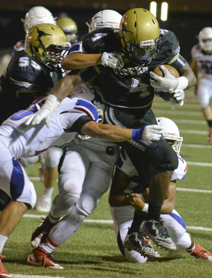 Big Spring's Preston Alexander battles for more yards Friday 9-25-2015 as a gang of Graham defenders try to bring him down. Tim Fischer\Reporter-Telegram Photo: Tim Fischer