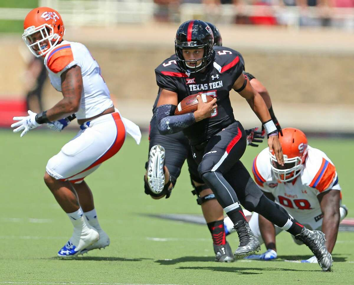Texas Tech quarterback Patrick Mahomes (5) rushes around two Bearkat defenders during Tech's game against Sam Houston State on Sept. 5 in Lubbock.