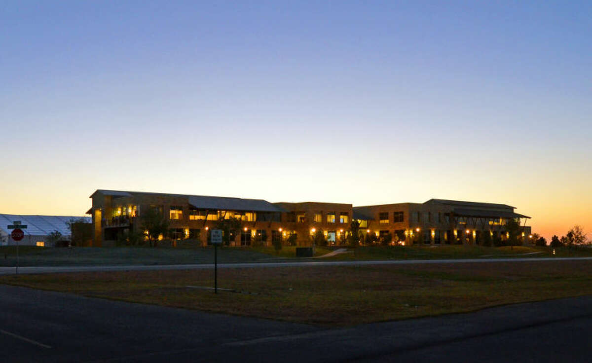 """Fasken Oil & Ranch Corporate Headquarters at sunset after a dinner service and ribbon cutting ceremony for """"The Vineyard,"""" a 1,000 acre planned master community built by Fasken that will feature retail, office and single and multifamily residential buildings. James Durbin/Reporter-Telegram"""