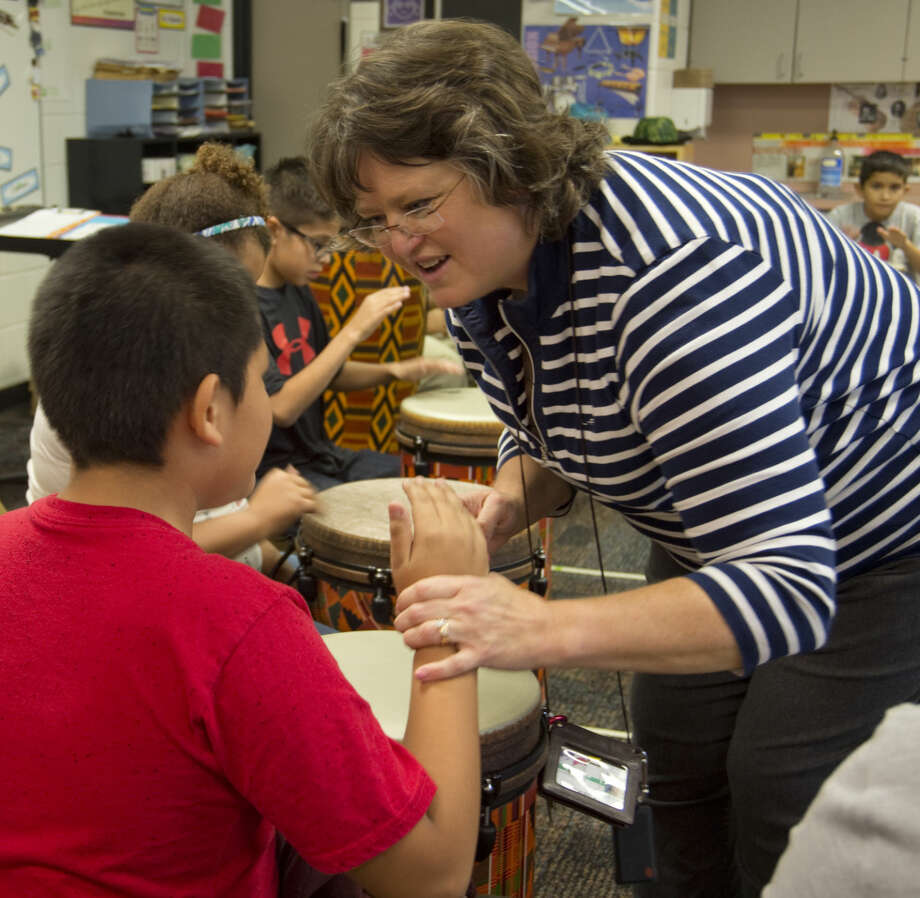 Stephanie Markgraf, music and fine arts teacher at Burnet Elementary, instructs students Wednesday 9-9-2015 on the drum. Tim Fischer\Reporter-Telegram Photo: Tim Fischer