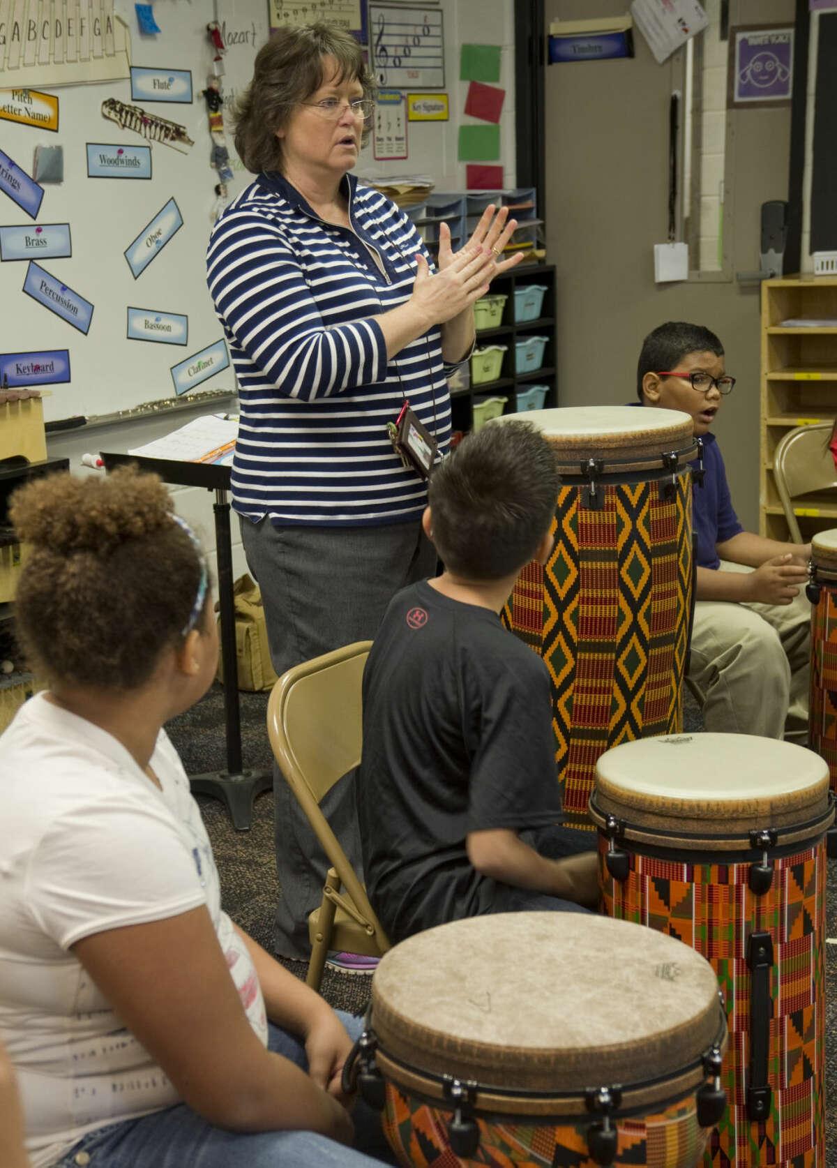 Stephanie Markgraf, music and fine arts teacher at Burnet Elementary, instructs students Wednesday 9-9-2015 on the drum. Tim Fischer\Reporter-Telegram