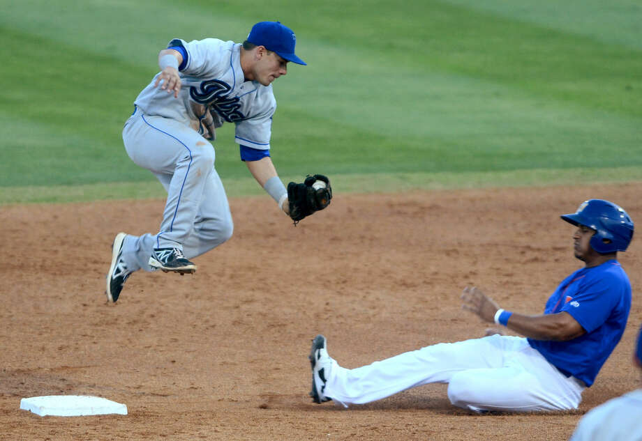 Rockhounds Jefry Marte tries to slide under Tulsa Drillers second baseman Jose Rivera on Thursday at Security Bank Ballpark. James Durbin/Reporter-Telegram Photo: James Durbin