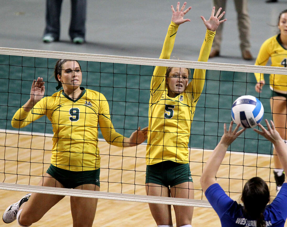 Midland College's Shelby Bartley (9) and DeeAnn Greehey (5) try to block a hit from Western Texas College on Wednesday, Sept. 23, 2015 at Chaparral Center. James Durbin/Reporter-Telegram