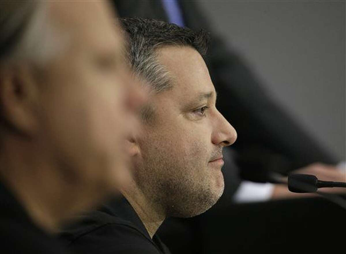 Three-time NASCAR champion Tony Stewart announces he will retire after the 2016 season during a news conference at Stewart-Haas Racing's headquarters in Kannapolis, N.C., Wednesday, Sept. 30, 2015. (AP Photo/Chuck Burton)