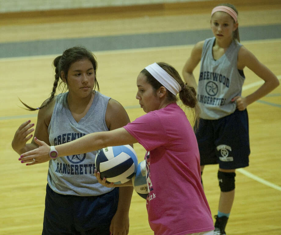 Greenwood volleyball coach Pam Schelhouse works with her players Thursday during practice. Tim Fischer\Reporter-Telegram Photo: Tim Fischer
