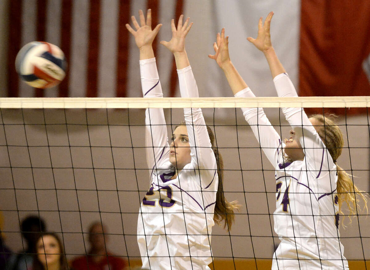 Midland High's Sarah Nelson (23) and Gentry Foreman (24) attempt to block a hit from San Angelo Central on Tuesday, Sept. 29, 2015, at Midland High. James Durbin/Reporter-Telegram