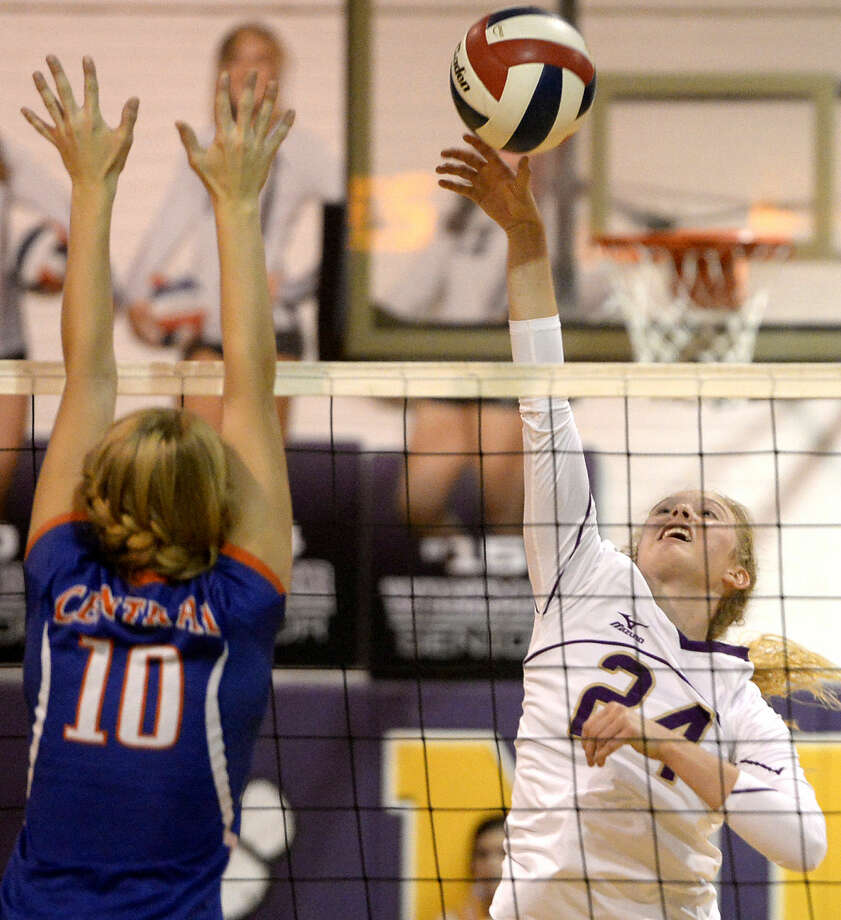 Midland High middle hitter Gentry Foreman (24) hits against San Angelo Central side on Tuesday, Sept. 29, 2015, at Midland High. James Durbin/Reporter-Telegram Photo: James Durbin