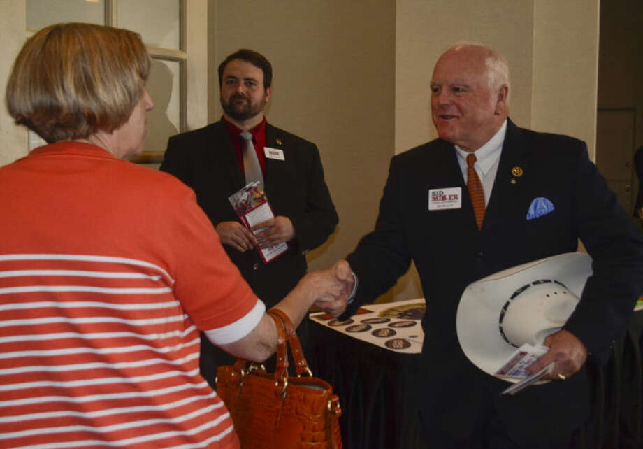 Sid Miller, running for Texas Agriculture Commissioner, greets Jo Sneed Wednesday before the Midland County Republican Women's luncheon. Tim Fischer\Reporter-Telegram Photo: Tim Fischer