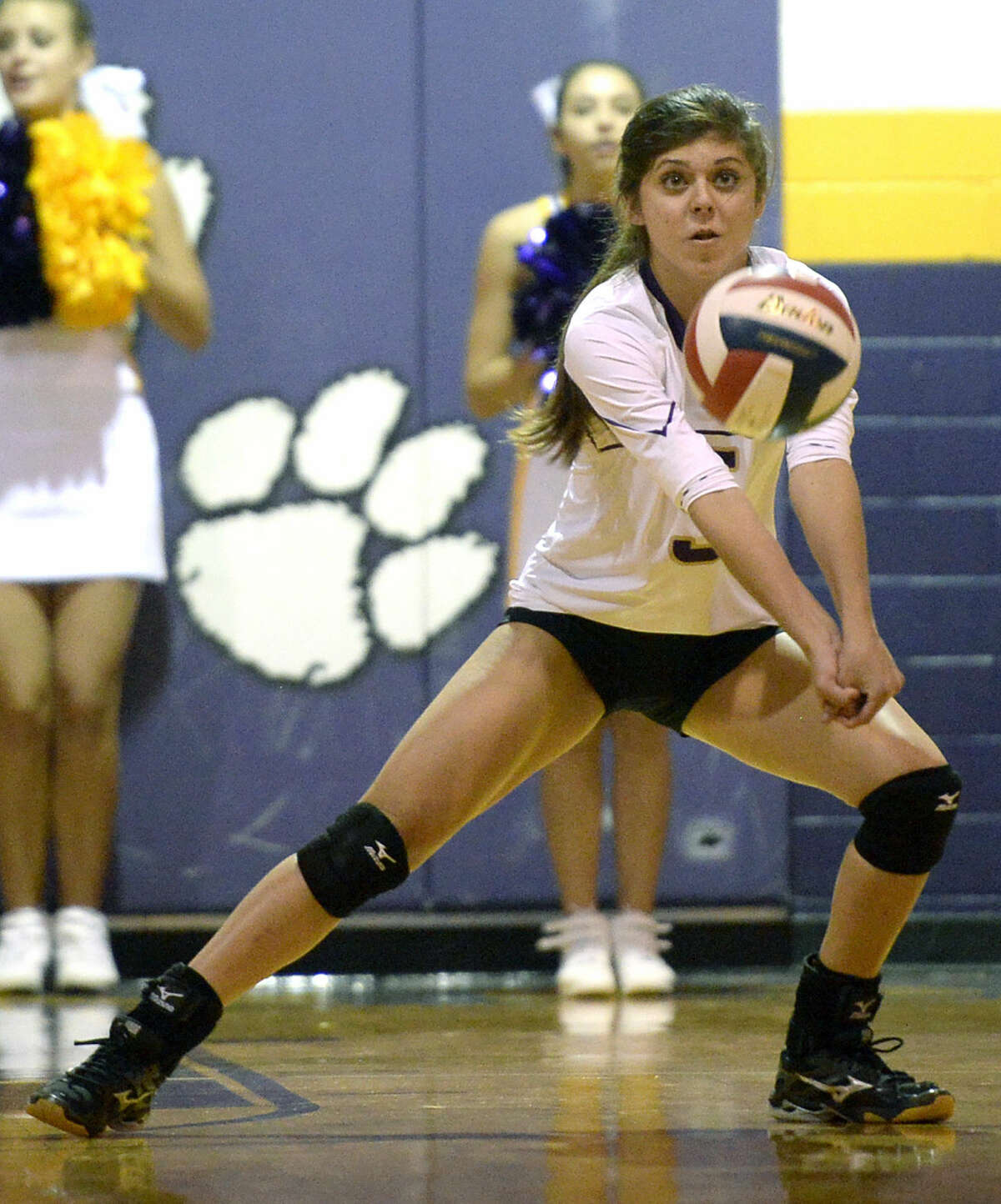 Midland High's Elizabeth Low (5) receives a serve from San Angelo Central on Tuesday, Sept. 29, 2015, at Midland High. James Durbin/Reporter-Telegram